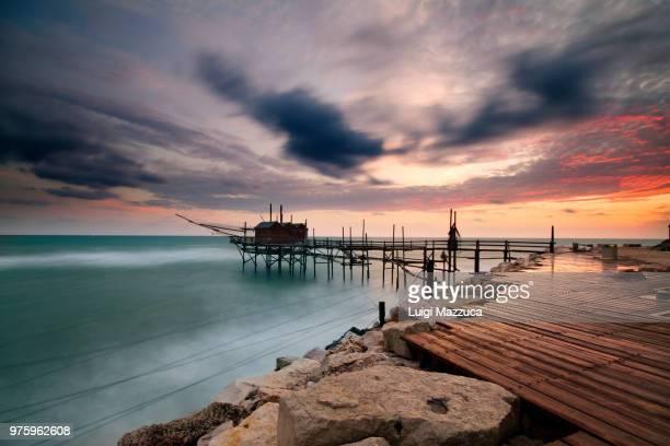 termoli trabucco pier on adriatic sea at sunset, termoli, molise, italy - molise foto e immagini stock