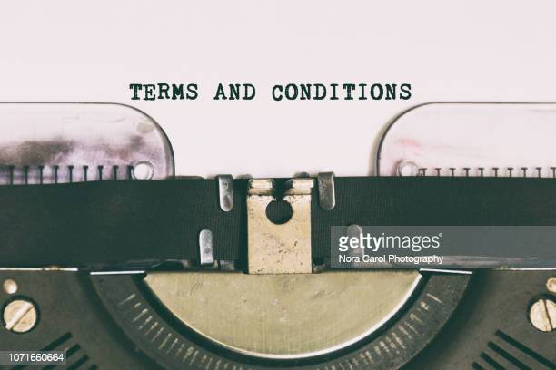 terms and conditions typed on vintage typewriter - employment law stock photos and pictures