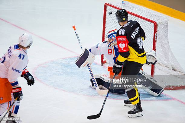 Tero Koskiranta of Lappeenranta making mask Teemu Lassila of Tampere during the Champions Hockey League Round of 32 match between SaiPa Lappeenranta...