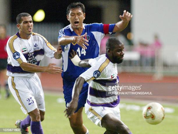 BEC Tero of Thailand Worrawoot Srimaka battles for the ball with Al Ain of United Arab Emirates Kadjo Julien Afanou and Humaid Fakher Husain Majeed...