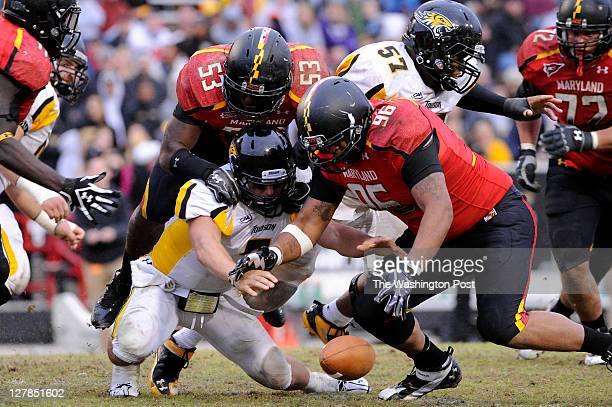 Terps' AJ Francis recovers a third quarter fumble by Towson QB Peter Athens