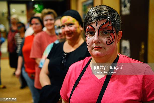 """Terra Smith """"Qookie the Clown"""" of Erie, Pennsylvania, waits in line with her colleagues for the judges after the face painting competiton at the 2011..."""