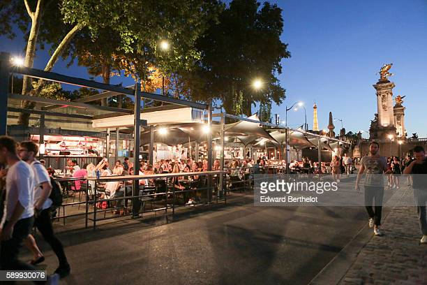 A terrace bar restaurant is seen and is located next to the river La Seine near the bridge Alexandre iii between the 7th and 8th quarter of Paris on...