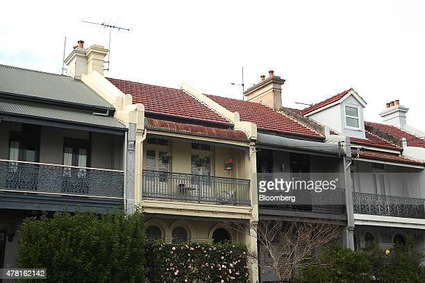 Terrace houses stand in the suburb of Balmain in Sydney Australia on Thursday June 18 2015 Surging home prices in cities including Sydney are...