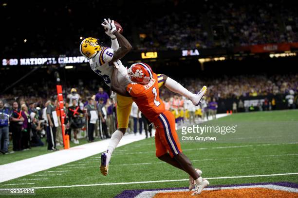 Terrace Marshall Jr #6 of the LSU Tigers scores a touchdown against Clemson Tigers in the College Football Playoff National Championship game at...