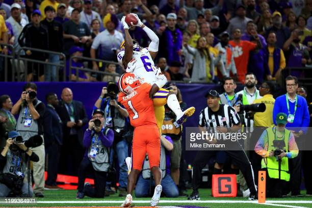Terrace Marshall Jr #6 of the LSU Tigers scores a touchdown over Derion Kendrick of the Clemson Tigers in the College Football Playoff National...