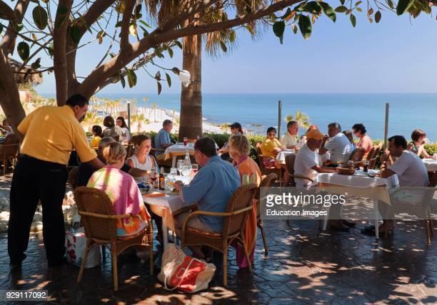 Terrace of La Cala restaurant, Benalmadena-Costa, Malaga Province, Costa del Sol, Spain.
