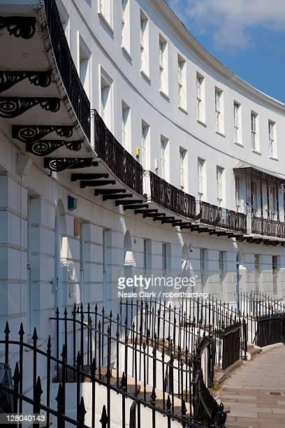 terrace of regency style georgian houses with wrought iron balconies on the royal crescent, cheltenham spa, gloucestershire, england, united kingdom, europe - regency style stock photos and pictures