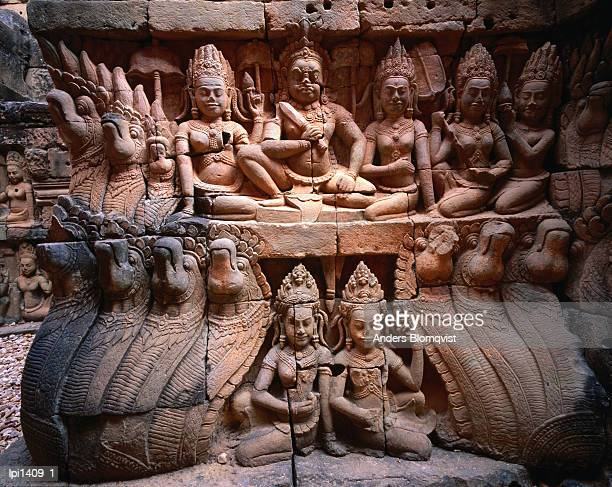 terrace of the leper king at angkor thom depicting king surrounded by apsara and snake monsters, angkor, siem reap, cambodia, south-east asia - classical mythology character stock photos and pictures