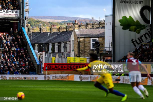 Terraced houses are seen through a gap in the stand at Turf Moor home stadium of Burnley during the Premier League match between Burnley FC and...