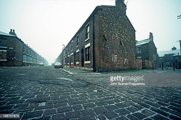Terraced houses on cobbled streets lined with setts in Manchester England in 1976
