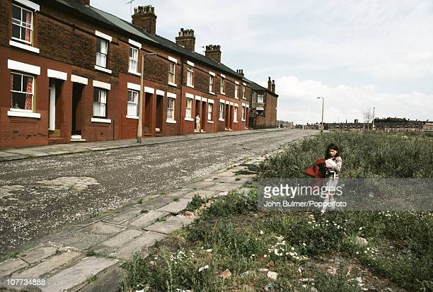 Terraced housing opposite a patch of wasteground in Manchester England in 1976