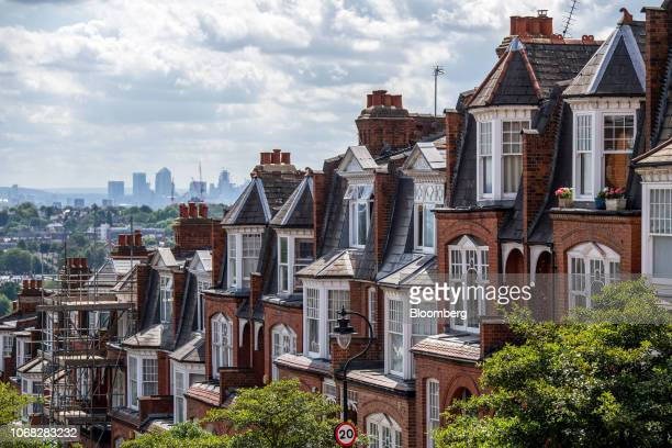 Terraced row of residential housing sits in the Muswell Hill district, in view of the Canary Wharf financial, business and shopping district of...