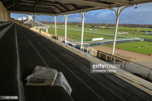 Terraces and stands remain empty after today's racing at Doncaster Racecourse was cancelled due to the equine flu outbreak on February 07 2019 in...