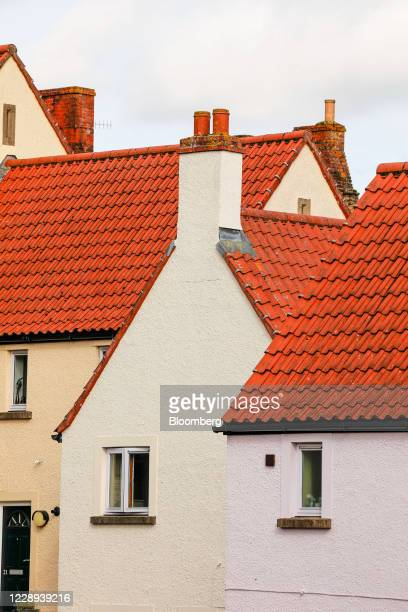 Terracotta colored roof tiles stand on residential houses in Frome, U.K., on Wednesday, Oct. 7, 2020. U.K. House prices rose at their strongest...