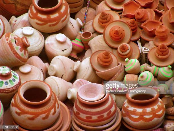 terracotta pottery is on sale at a street of karachi - pakistani culture stock photos and pictures