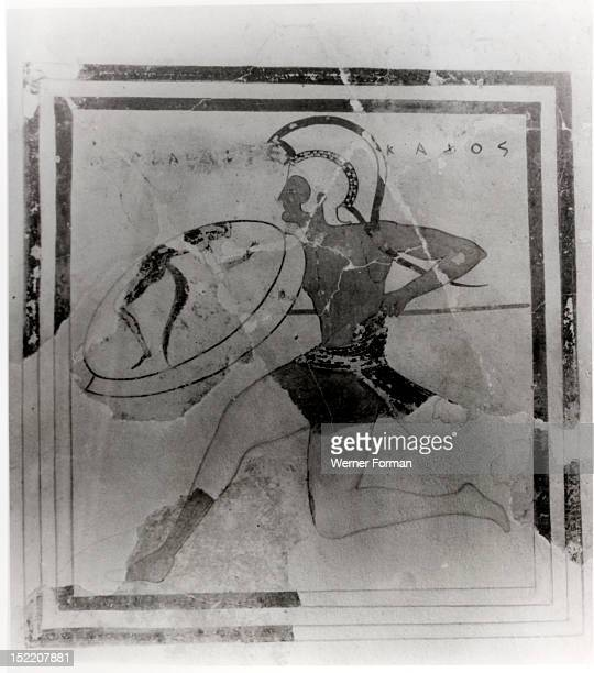 A terracotta slab painted with a running hoplite carrying a spear and shield Greece Ancient Greek Classical period 5th century BC