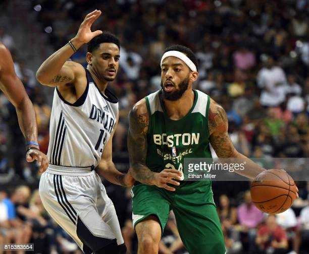 Terran Petteway of the Boston Celtics drives against Corey Webster of the Dallas Mavericks during the 2017 Summer League at the Thomas Mack Center on...