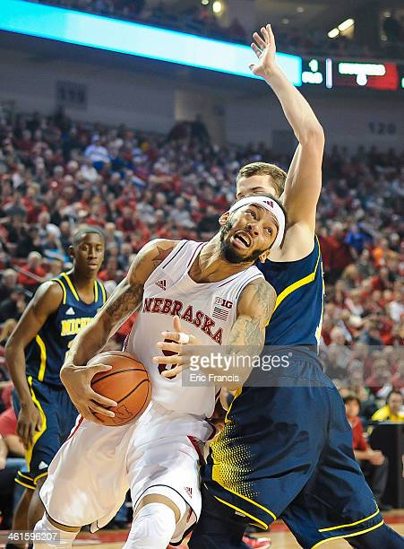 Terran Petteway of the Nebraska Cornhuskers drives past Nik Stauskas of the Michigan Wolverines during a game at the Pinnacle Bank Arena on January 9...