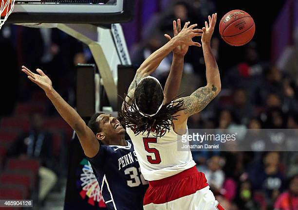 Terran Petteway of the Nebraska Cornhuskers looses control of the ball under pressure from Jordan Dickerson of the Penn State Nittany Lions during...