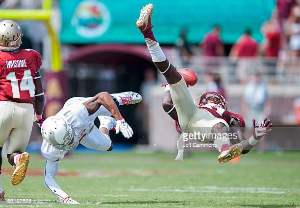 Terrance Brooks of the Florida State Seminoles and Adam Greene of the Maryland Terrapins go after a loose ball during the second half on October 5,...