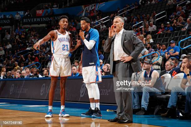 Terrance Ferguson Andre Roberson Head Coach Billy Donovan of the Oklahoma City Thunder look on against the Detroit Pistons during a preseason game on...