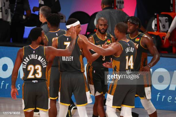 Terrance Ferguson, Darius Bazley, Chris Paul, Devon Hall, and Luguentz Dort of the Oklahoma City Thunder celebrate after defeating the Washington...