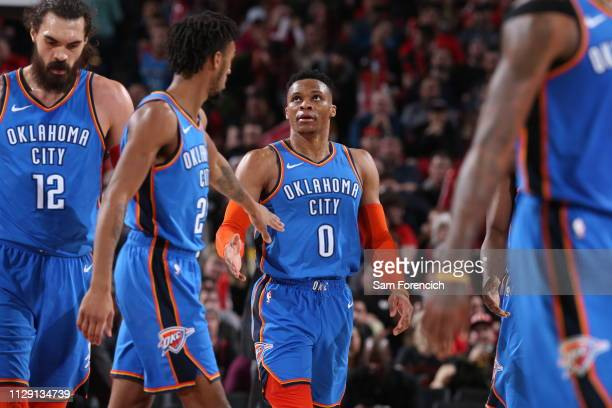 Terrance Ferguson hi-fives Russell Westbrook of the Oklahoma City Thunder on March 7, 2019 at the Moda Center Arena in Portland, Oregon. NOTE TO...