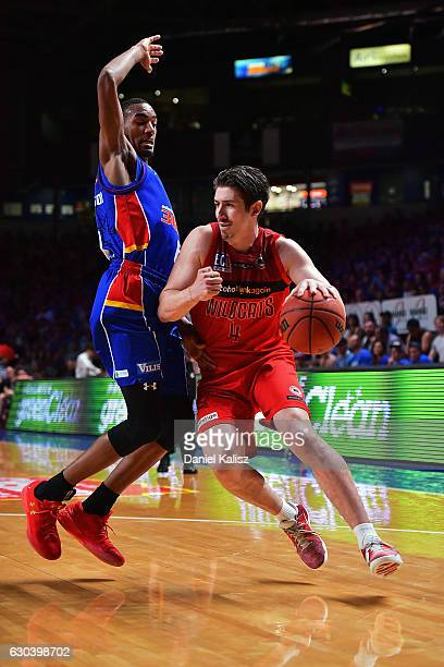 Terrance Ferguson of the Adelaide 36ers defends agains Greg Hire of the Perth Wildcats during the round 12 NBL match between the Adelaide 36ers and...