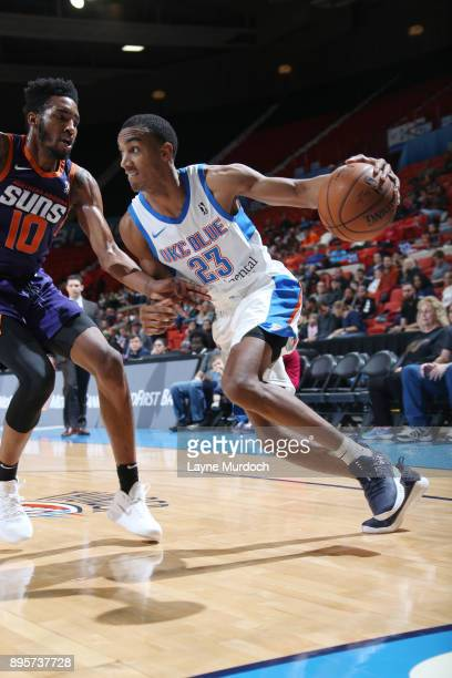 Terrance Ferguson of the Oklahoma City Blue handles the ball against Derrick Jones Jr #10 of the North Arizona Suns during an NBA GLeague game on...