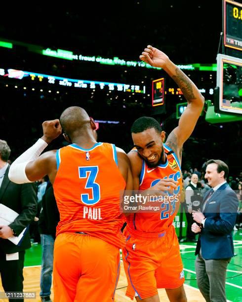 Terrance Ferguson of the Oklahoma City Thunder and Chris Paul of the Oklahoma City Thunder celebrate after the victory over the Boston Celtics at TD...