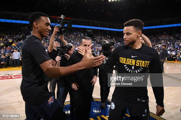 Terrance Ferguson of the Oklahoma City Thunder and Stephen Curry of the Golden State Warriors shake hands before the game on February 6 2018 at...