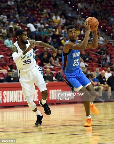 Terrance Ferguson of the Oklahoma City Thunder drives against BJ Johnson of the Charlotte Hornets during the 2018 NBA Summer League at the Thomas...