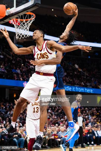 Terrance Ferguson of the Oklahoma City Thunder dunks over Rodney Hood of the Cleveland Cavaliers during the first half at Quicken Loans Arena on...