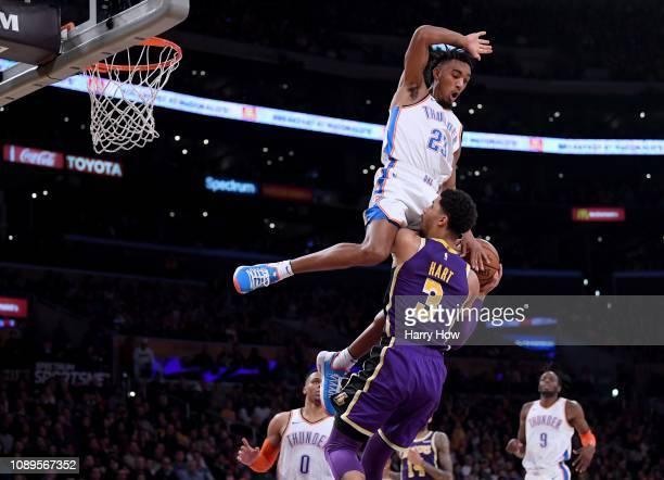 Terrance Ferguson of the Oklahoma City Thunder fouls Josh Hart of the Los Angeles Lakers during a 107100 Thunder win at Staples Center on January 02...
