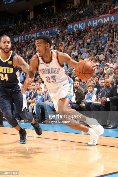 Terrance Ferguson of the Oklahoma City Thunder handles the ball against the Denver Nuggets on March 30 2018 at Chesapeake Energy Arena in Oklahoma...