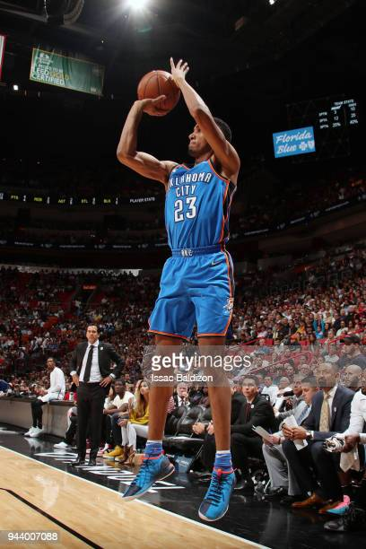Terrance Ferguson of the Oklahoma City Thunder shoots the ball against the Miami Heat on April 9 2018 at American Airlines Arena in Miami Florida...