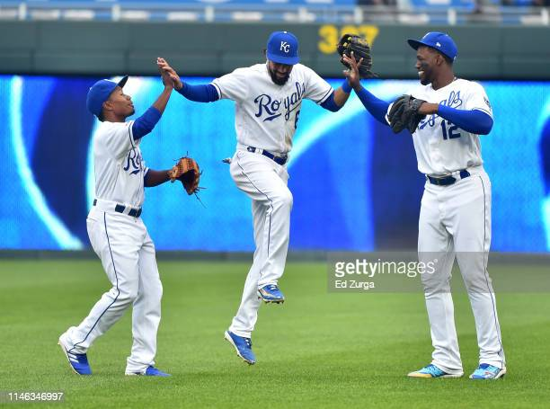 Terrance Gore, Billy Hamilton and Jorge Soler of the Kansas City Royals celebrate an 8-2 win over the Tampa Bay Rays in game two of a doubleheader at...