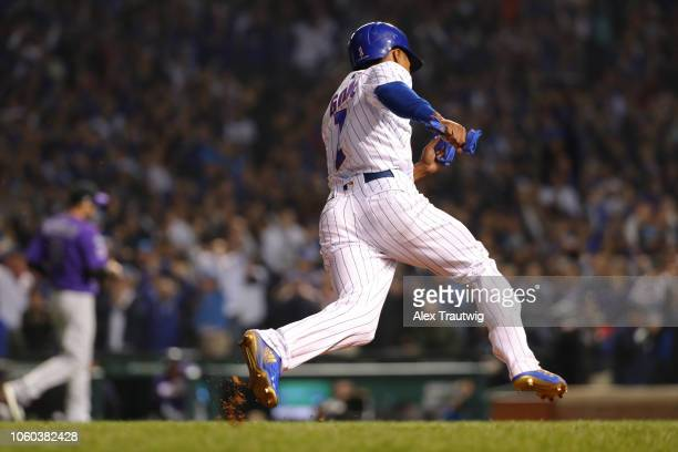 Terrance Gore of the Chicago Cubs heads home to score a run during the National League Wild Card game against the Colorado Rockies at Wrigley Field...