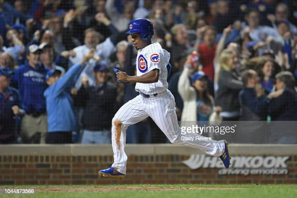 Terrance Gore of the Chicago Cubs scores a run in the eighth inning against the Colorado Rockies after a RBI double by Javier Baez during the...