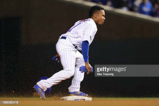 Terrance Gore of the Chicago Cubs steals second base during the National League Wild Card game against the Colorado Rockies at Wrigley Field on...
