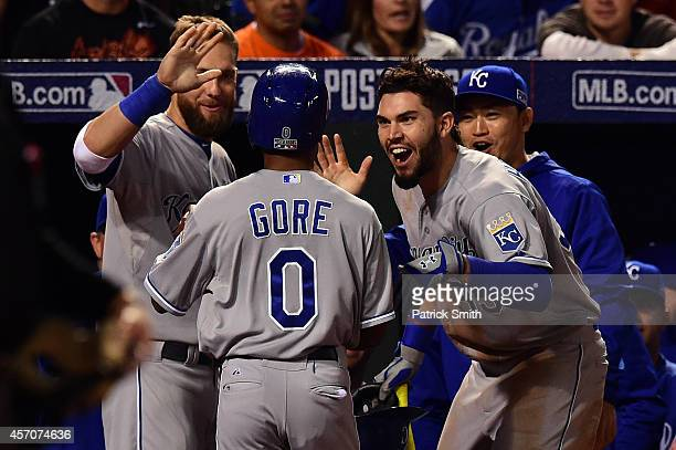 Terrance Gore of the Kansas City Royal celebrates with his teammates after scoring on Alcides Escobar double to right field in the ninth inning...