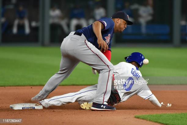 Terrance Gore of the Kansas City Royals slides into second for a steal past second baseman Jonathan Schoop of the Minnesota Twins in the eighth...