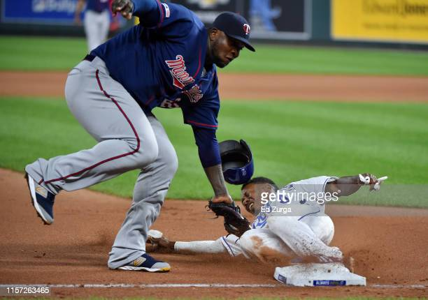Terrance Gore of the Kansas City Royals slides into third for a steal past the tag of third baseman Miguel Sano of the Minnesota Twins in the eighth...