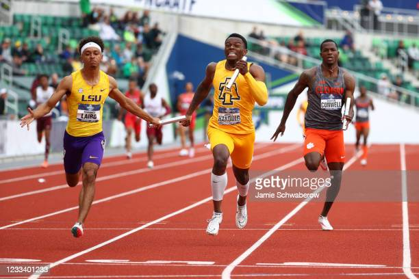 Terrance Laird of the LSU Tigers competes in the mens 4x100 relay against Javonte Harding of the North Carolina A&T Aggies and Terryon Conwell of the...