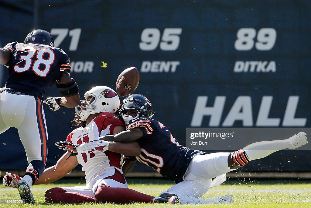 Terrance Mitchell #20 of the Chicago Bears and Adrian Amos #38 break up a pass intended for Larry Fitzgerald #11 of the Arizona Cardinals during the fourth quarter at Soldier Field on September 20, 2015 in Chicago, Illinois.