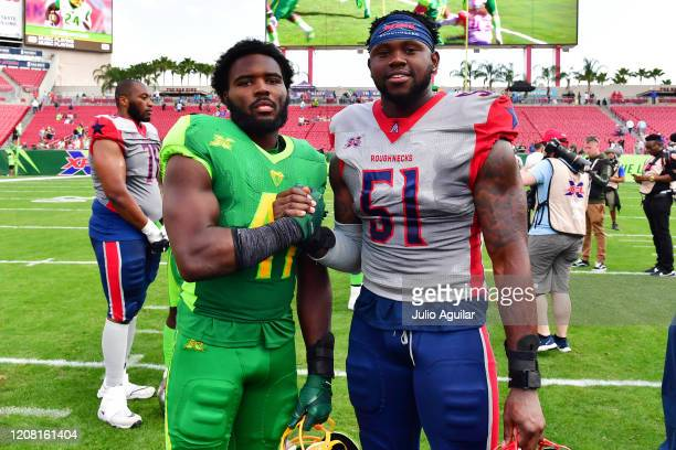Terrance Plummer of the Tampa Bay Vipers poses with past Minnesota Vikings teammate Edmond Robinson of the Houston Roughnecks after a game at Raymond...