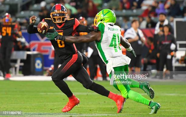 Terrance Plummer of the Tampa Bay Vipers strips the ball away from Josh Johnson of the LA Wildcats at Dignity Health Sports Park during an XFL game...