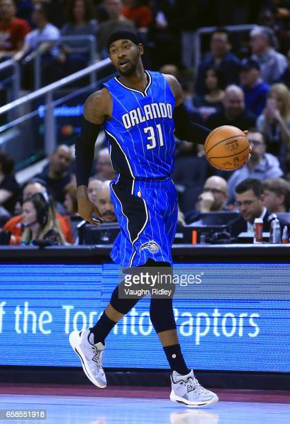 Terrance Ross of the Orlando Magic dribbles the ball during the first half of an NBA game against the Toronto Raptors at Air Canada Centre on March...