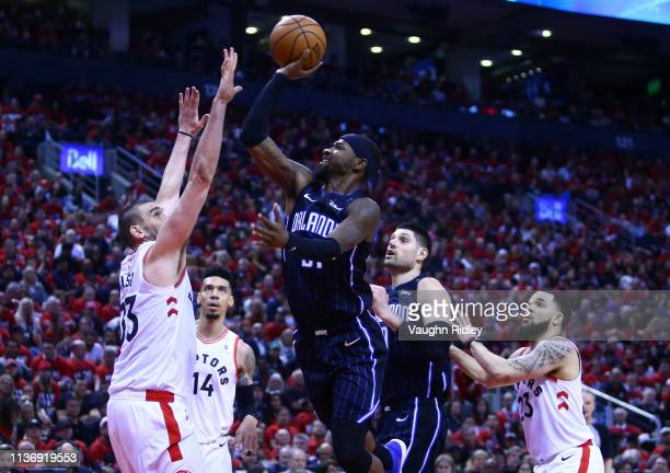 Terrance Ross of the Orlando Magic shoots the ball as Marc Gasol of the Toronto Raptors defends during Game One of the first round of the 2019 NBA...